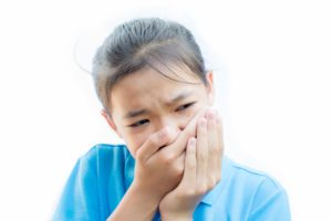 asian-girl-felling-toothache-on-white-background-t-6G6VQKP (1)